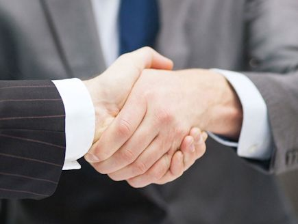 Residential Closings with a handshake at Priority Title, LLC